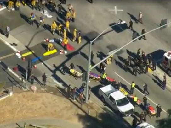 First responders gather on a nearby street corner as