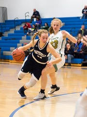 Marysville High School's Gabby Fogarty (left) dribbles the ball around POntiac Notre Dame Prep's Gretel Keller during the MHSAA Girls Basketball Class B regional game at Cros-Lex High School March 6.