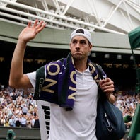 John Isner of the US exits Centre Court following his defeat at the hands of Kevin Anderson of South Africa in their semi final match during the Wimbledon Championships at the All England Lawn Tennis Club, in London, Britain, 13 July 2018.