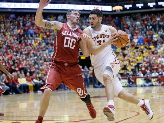 Iowa State forward Georges Niang drives past Oklahoma forward Ryan Spangler, left, during the second half of an NCAA college basketball game, Monday, Jan. 18, 2016, in Ames, Iowa. Niang scored 22 points as Iowa State won 82-77. (AP Photo/Charlie Neibergall)