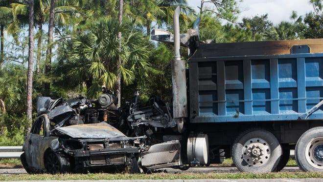 A fatal crash occurred between a dump truck and a car at Collier and Veronawalk boulevards on Tuesday, Oct. 18, 2016. One person died in the crash.