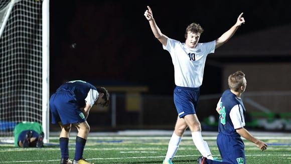 Jack Sandstedt celebrates a goal in the playoff game