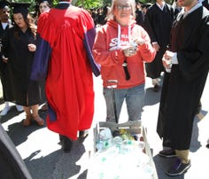 Graduates enter the tent for Bard College's 155th commencement ceremony.