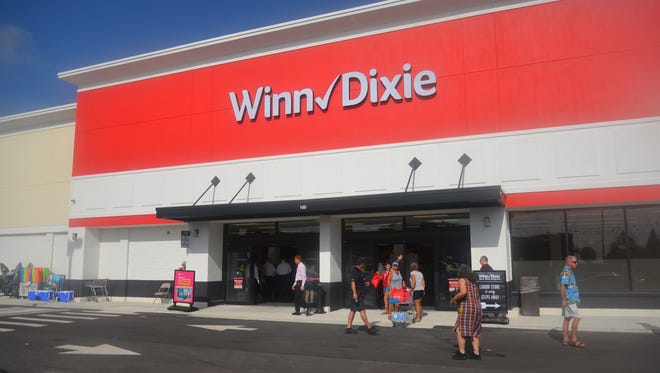 The Winn Dixie in Cocoa Beach, closed since Hurricane Matthew, opened Wednesday morning with a mass ribbon cutting, speeches, samples and mystery gift cards to the first 500 people in line. About 700 people showed up for the opening of the totally revamped store.