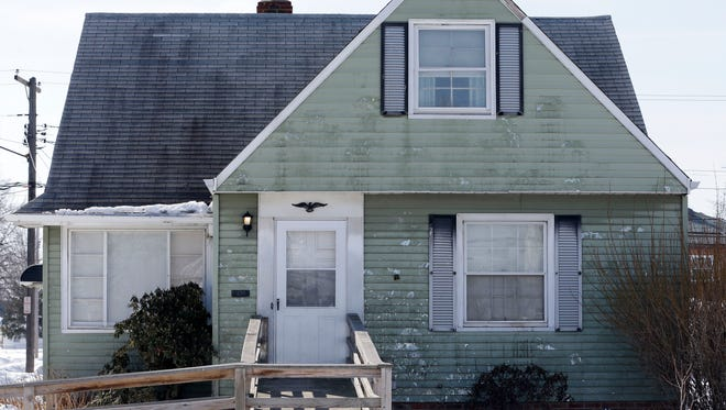 A home that has been pelted with eggs several times a week for a year is shown Friday, March 6, 2015, in Euclid, Ohio. Police haven't been able to crack the unusual case despite doing stakeouts, questioning neighbors, installing a surveillance camera and even testing eggshells as evidence. (AP Photo/Tony Dejak)