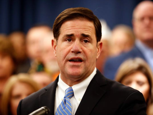 Ducey faces backlash for photo with Patriot Movement AZ activists