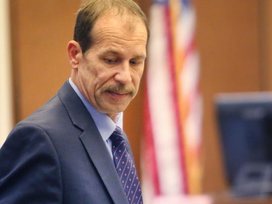 Theodore Wafer, 55, of Dearborn Heights stands up after day one of his trial in the Wayne County Circuit Court in Detroit Wednesday, July 23, 2014.