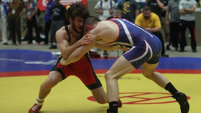 Iowa's Thomas Gilman (red) swept the freestyle best-of-three championship series at 121 pounds against Nathan Tomasello at the World  Team Trials.