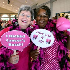 ABOVE: Cancer survivors Frances Yeo, left, and Angela Anglin have some fun during the Making Strides Against Breast Cancer kickoff Thursday at the Sanders Beach/Corrine Jones Center. For information on local walks against breast cancer visit http://bit.ly/1nJApVu.