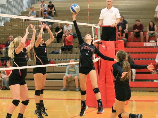 Elevating to tip the ball over the net during a recent game is Canton senior setter Sabrina Giacomini.