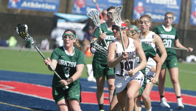Action during a girls lacrosse game between Yorktown and Bayport-Blue Point in the Gains for Brains Lax Showcase at Cold Spring Harbor High School on Saturday, April 16th, 2016.