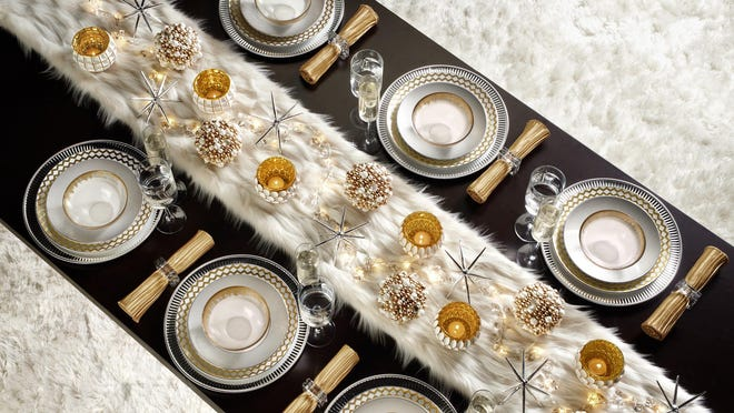 Z Gallerie stores are filled with sparkly décor, including their gold Solaris and Helios dinnerware that makes for a glittery New Year's Eve tablescape.
