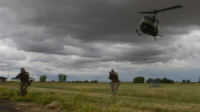 Airmen with the 741st Tactical Response Force train on tactics with the 40th Helicopter Squadron at a training site at Malmstrom Air Force Base.