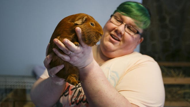 Kristina Francis holds her guinea pig Rusty. Francis recently started Apollo Cavy Sanctuary and has already found homes for four guinea pigs.