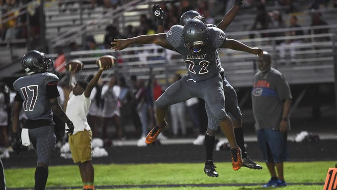 In a photo from last year, Palm Beach Lakes running back Antonio Outler (22) celebrates his second-quarter touchdown with teammate Micah Butler (10) in a win over Pahokee. Outler is one of six returning starters from last year's team.