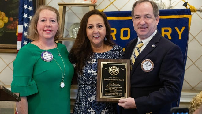 From left, Rotary's Elizabeth DeBrule; Jesse Newman Award-winner Irene Sobrino, outreach and patient navigator at Cancer Alliance of Health and Hope; and Stanton Collemer, chief executive officer of Cancer Alliance of Health and Hope, show the Jesse Newman Spirit of Palm Beach Award.