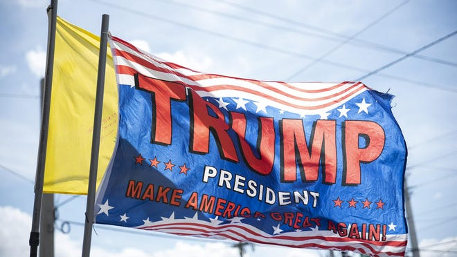 Flags with pro-Trump designs are seen along Southern Boulevard during President Trump's visit to Palm Beach County on Sunday, March 24, 2019, in West Palm Beach, FL.