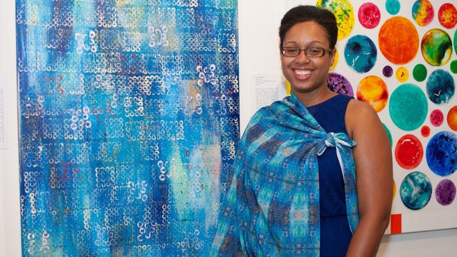 "Lake Worth Beach artist Shani Simpson posed alongside her acrylic painting ""New Day"" at the Cultural Council for Palm Beach County's 2015 biennial exhibition. She is one of 79 artists who have received a grant from the council's Palm Beach County Artist Relief Fund."