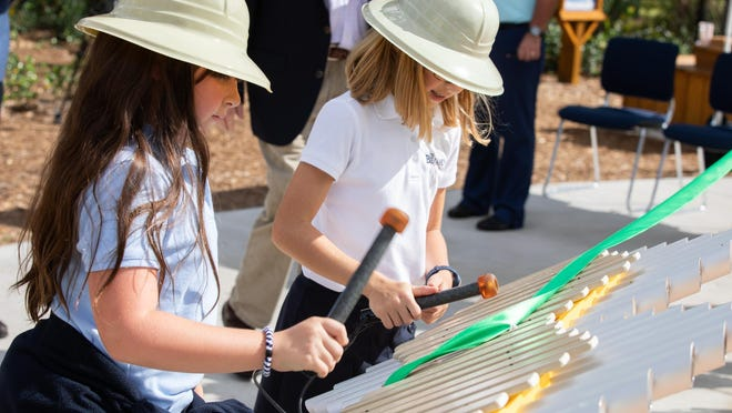 WEST PALM BEACH -- Benjamin School students Ava Shawe (left) and Hannah MacMillan learn about sound in the Physics Forest on the new Fisher Family Science Trail at the South Florida Science Center and Aquarium in West Palm Beach.