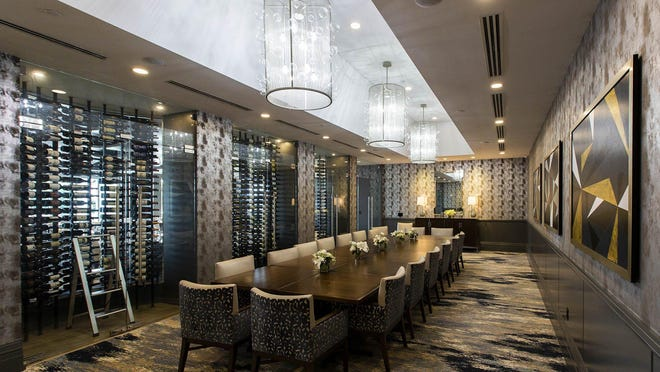 "A private dining room in the ""Flavours"" formal dining restaurant features a wine wall. Wycliffe Golf and Country Club in Wellington on Wednesday, Jan. 8, 2020, has completed an $18.2 million renovation project that improved the clubhouse's restaurants, fitness and spa areas."