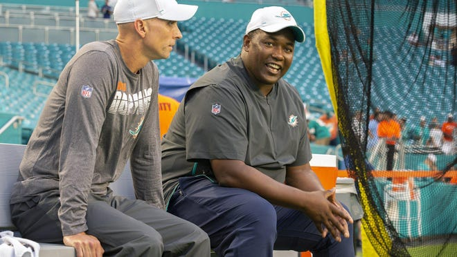 Miami Dolphins offensive coordinator Chad O'Shea talks with defensive coordinator Patrick Graham.