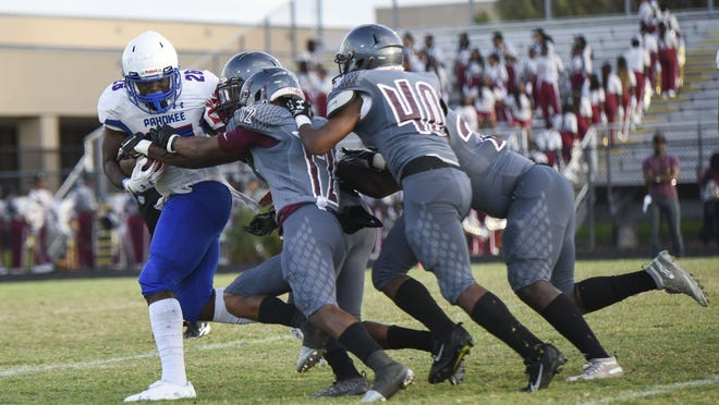 Pahokee running back Corey Polk (26) is tackled by a host of Palm Beach Lakes defenders during the game between Pahokee and Palm Beach Lakes at Palm Beach Lakes in West Palm Beach, FL, on Thursday, September 19, 2019. Final score, Palm Beach Lakes, 48, Pahokee, 0.