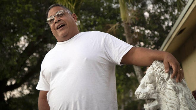 Luis Rojo outside his home in suburban West Palm Beach.