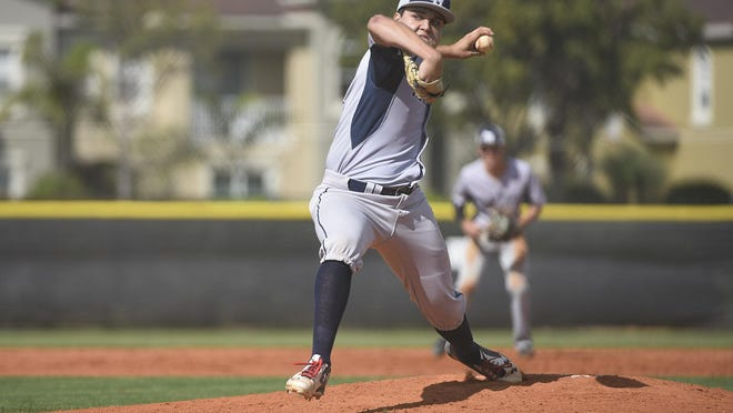 In this 2018 photo, American Heritage pitcher Nelson Berkwich  delivers a pitch at the bottom of the first inning during a  game against  Benjamin in Palm Beach Gardens. Berkwich signed with Vanderbilt last month and hopes to lead American Heritage to a state title this spring.