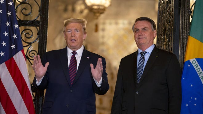 President Donald Trump with Brazilian President Jair Bolsonaro at Mar-a-Lago in Palm Beach, Saturday night, March 7, 2020. Trump's populist counterpart in Brazil was elected in 2018 vowing to ?Make Brazil great again.?