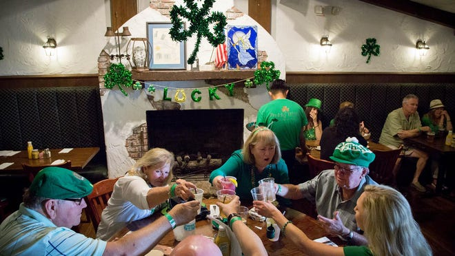 Maureen Strahan, Juno Beach, (center, right) makes a toast with friends celebrating St. Patrick's Day at Paddy Mac's in Palm Beach Gardens in 2018. The eatery will celebrate its 25th anniversary this year.