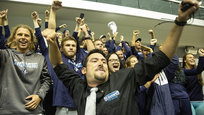 Keiser University's swimming Head Coach Adam Epstein cheers his men's 4x100 free relay to the victory that sealed the deal for the men's program three-peat during Final Day of NAIA Swimming Championship at the Allen Jones Aquatic Center Friday Mar 6, 2020 in Knoxville.