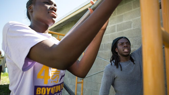 Two Boynton Beach High School students, take down scaffolding at a Habitat for Humanity of South Palm Beach build site in 2014 in Boynton Beach.