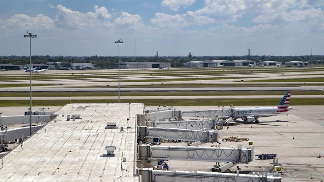 A single plane is parked at a concourse at Palm Beach International Airport on May 6, as travel has taken a huge hit since the coronavirus pandemic hit in March.