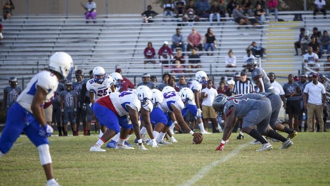 Pahokee and Palm Beach Lakes face off at the line of scrimmage during the first half of the game between Pahokee and Palm Beach Lakes at Palm Beach Lakes in West Palm Beach, FL, on Thursday, September 19, 2019.