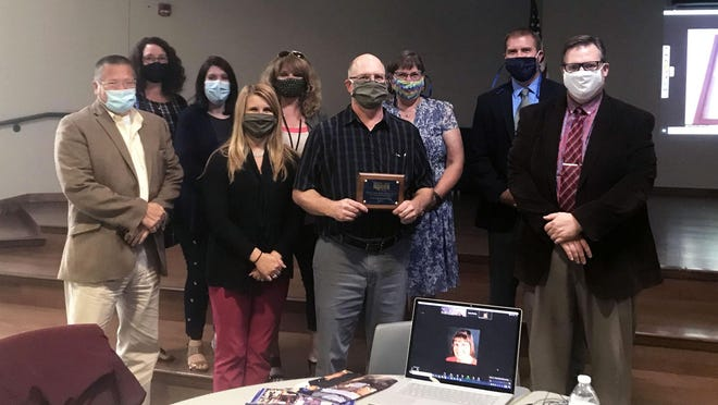 Herkimer-Fulton-Hamilton-Otsego BOCES presented Gehring-Tricot Corp. with the 2020 Herkimer BOCES Community Partnership Award during a Board of Education meeting Thursday, Sept. 3. From left are, front row: Skip Gehring, Gehring-Tricot president; Kayla Morrill, Gehring-Tricot human resources manager; Gary Farquhar Jr., Gehring-Tricot vice president of manufacturing, and Zane Mahar, Herkimer BOCES principal of technical education; and, back, Kelly Rowland, Herkimer BOCES special education coordinator; Rebecca Roberts, Herkimer BOCES School to Careers school counselor; MaryBeth Napolitano, Herkimer BOCES School to Careers liaison;   Sandra Sherwood, Herkimer BOCES district superintendent, and Phillip Keida, Herkimer BOCES assistant principal of technical education.