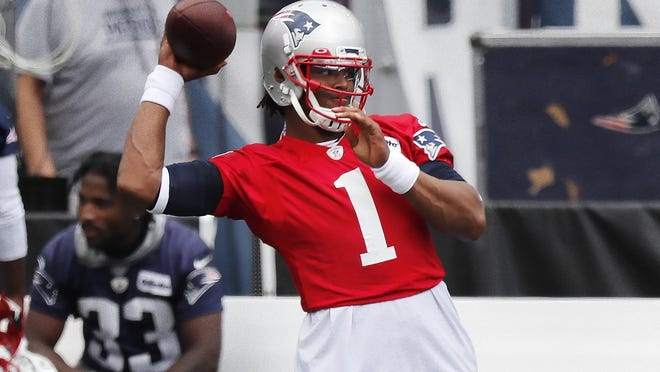 New England Patriots quarterback Cam Newton (1) warms up before an NFL football training camp scrimmage, Friday, Aug. 28, 2020, in Foxborough, Mass.