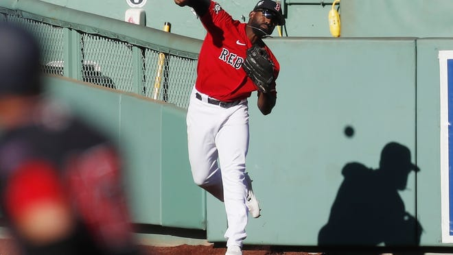 Boston Red Sox's Jackie Bradley Jr. throws the ball in after fielding a double by Washington Nationals' Yan Gomes on Sunday. Bradley becomes a free agent at season's end, but the Red Sox have said they would like to keep him in Boston.