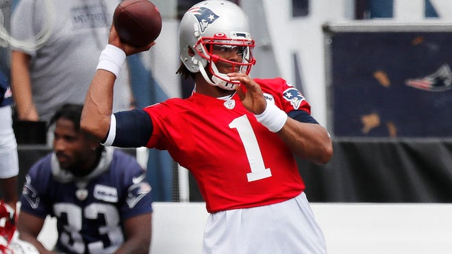 Patriots quarterback Cam Newton warms up before training camp last week.