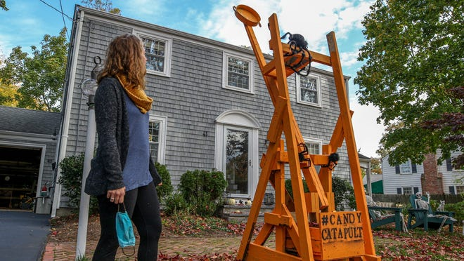 Barrington mom Lindsey Hingorany takes no credit for the building of this candy catapult her husband and sons erected for Halloween visitors.