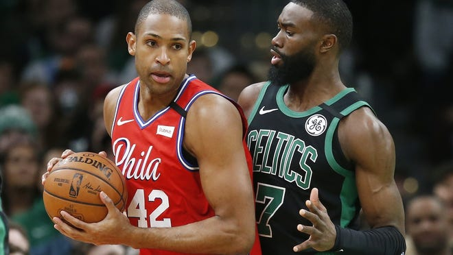 Boston Celtics' Jaylen Brown (7) defends against Philadelphia 76ers' Al Horford (42) during the first half of an NBA basketball game in Boston, Saturday, Feb. 1, 2020.