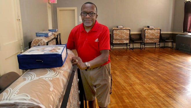 Scott Lewis stands next to a bed in the men's dorm for the homeless shelter at Freeport Area Church Cooperative in Freeport. After 15 years at FACC helping the homeless, he is moving on to new opportunities.