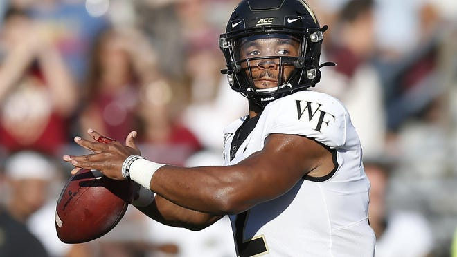 Wake Forest quarterback Jamie Newman passes during a game against Boston College in Boston on Sept. 28, 2019.