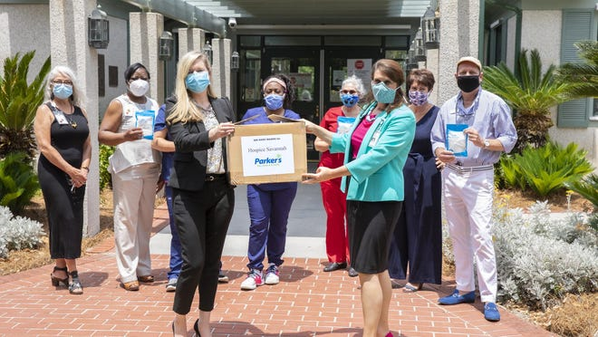 Parker's Chief of Staff Kate Smith, left, presented 300 KN95 face masks to Hospice Savannah President and CEO Dr. Kathleen D. Benton, right. To date, Parker's has donated more than 7,000 face masks to healthcare workers throughout coastal Georgia and South Carolina. [Photo courtesy of Parker's]