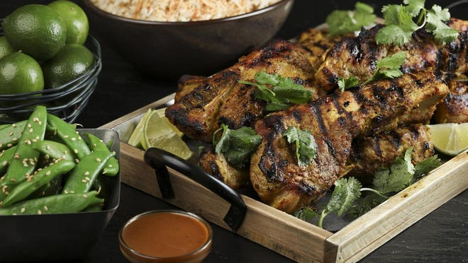 Pork country ribs marinate in a mixture of onion, garlic, ginger and lemongrass purees, fish sauce, chile, salt, pepper, coriander, cumin and turmeric before being grilled and then served with fresh lime and bottled peanut sauce.