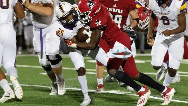 Savannah Christian's George Futch (3) stops Calvary Day's Brian Joiner (25) for a loss on Friday night at Pooler Stadium.
