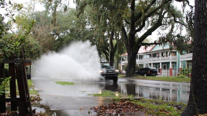 Motorists splashed through a gargantuan puddle on W. 37th St. in Savannah in 2019.