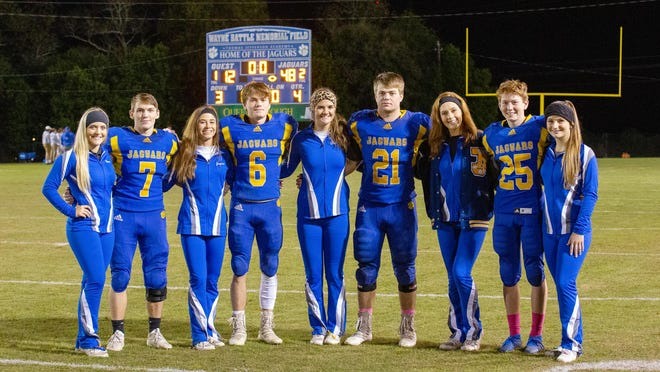 The Jaguars pictured here are all seniors who played their last game on TJA's home field Friday.