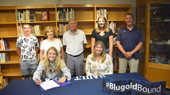 Jordan Scott was joined by family members and her high school track coach as she signed with Wisconsin-Eau Claire at the Sault High library this past week. Pictured front row, from left are Jordan Scott and her mother Amy Scott-Kronemeyer; back row from left: brother Maxwell Scott, grandparents Darlene and Mike Skinner, sister Mikaya Scott, and Sault High girls' track and field coach Scott Menard.