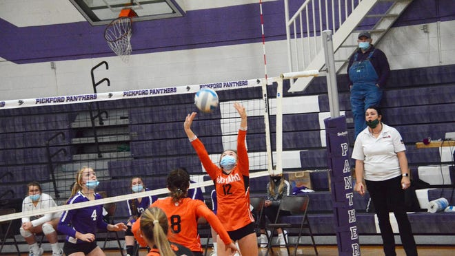 Rudyard's Chesney Molina (12) sets during an Eastern UP Conference volleyball match at Pickford earlier this season. The EUPC rivals meet again in a Division 4 regional at Pellston Tuesday night.