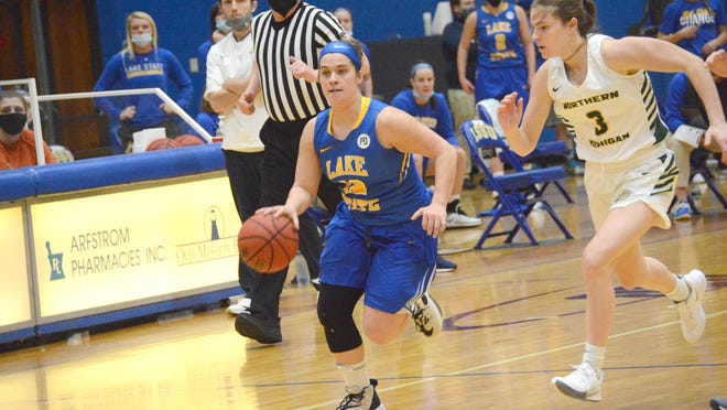 Lake Superior State's Taylor Bryant (12) leads a fast break, while Peyton Wright (3) of Northern Michigan defends during a GLIAC women's basketball game Sunday at the Bud Cooper Gym.